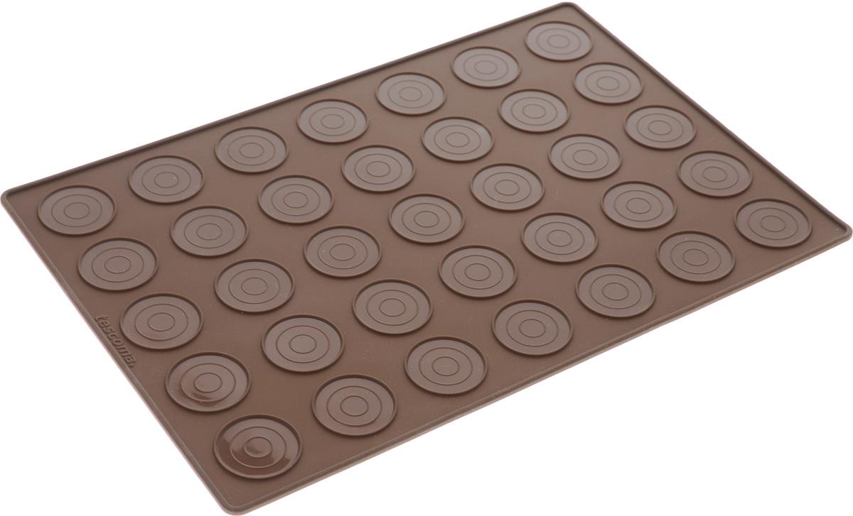 Форма для выпечки макарун Tescoma Delicia, 35 ячеек629358Форма для выпечки макарун Tescoma Delicia изготовлена из высококачественного силикона. Форма содержит 35 неглубоких ячеек.Простая в уходе и долговечная в использовании форма будет верной помощницей в создании ваших кулинарных шедевров. На упаковке имеются рецепты приготовления вкусных десертов.Можно мыть в посудомоечной машине.Размер формы: 32 x 22 х 0,3 см.Диаметр ячейки: 3,5 см.