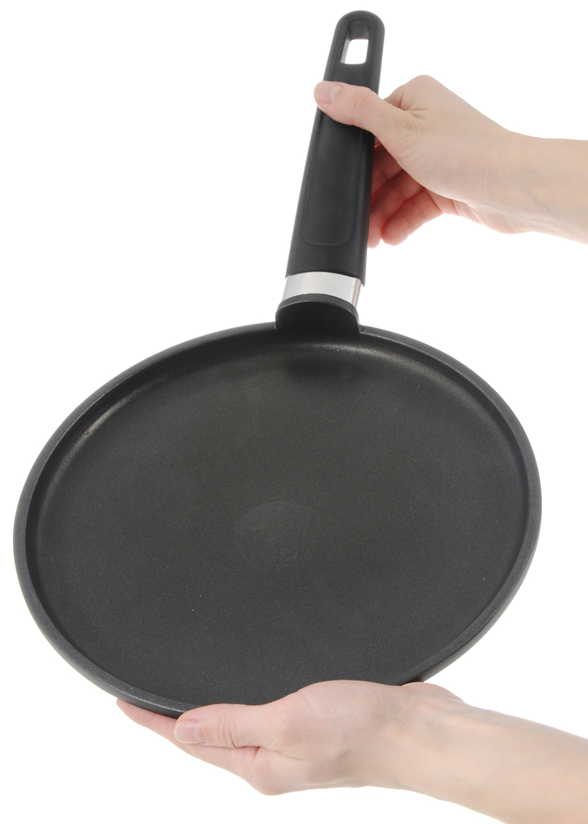"""Сковорода для блинов Tescoma """"Premium"""" изготовлена из алюминия с   высококачественным первоклассным антипригарным покрытием """"Teflon Classic"""".   Отличные антипригарные свойства покрытия позволяют готовить практически   без масла, что делает ваши блюда менее жирными и калорийными. Идеально   плоская поверхность с низкой кромкой подходит для приготовления блинчиков и   яичницы. Эргономичная ручка изготовлена из прочного пластика и нержавеющей   стали. Подходит для следующих типов плит - электрических, газовых, керамических.   Можно мыть в посудомоечной машине. Диаметр сковороды: 24 см. Высота стенки: 2 см. Длина ручки: 21 см. Толщина дна: 10 мм. Толщина стенки: 3 мм.    Простой рецепт блинов на Масленицу – статья на OZON Гид."""