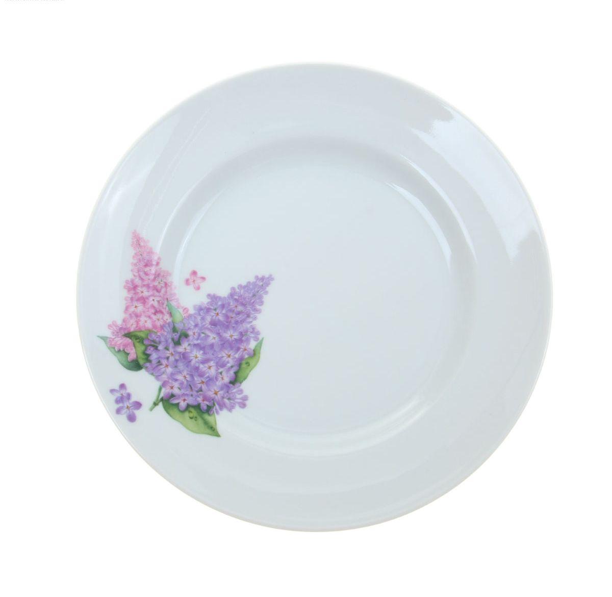 Тарелка мелкая Идиллия. Сирень, диаметр 20 см4С0189/1035432Мелкая тарелка Идиллия. Сирень выполнена из высококачественного фарфора и украшена ярким рисунком. Она прекрасно впишется в интерьер вашей кухни и станет достойным дополнением к кухонному инвентарю. Тарелка Идиллия. Сирень подчеркнет прекрасный вкус хозяйки и станет отличным подарком.