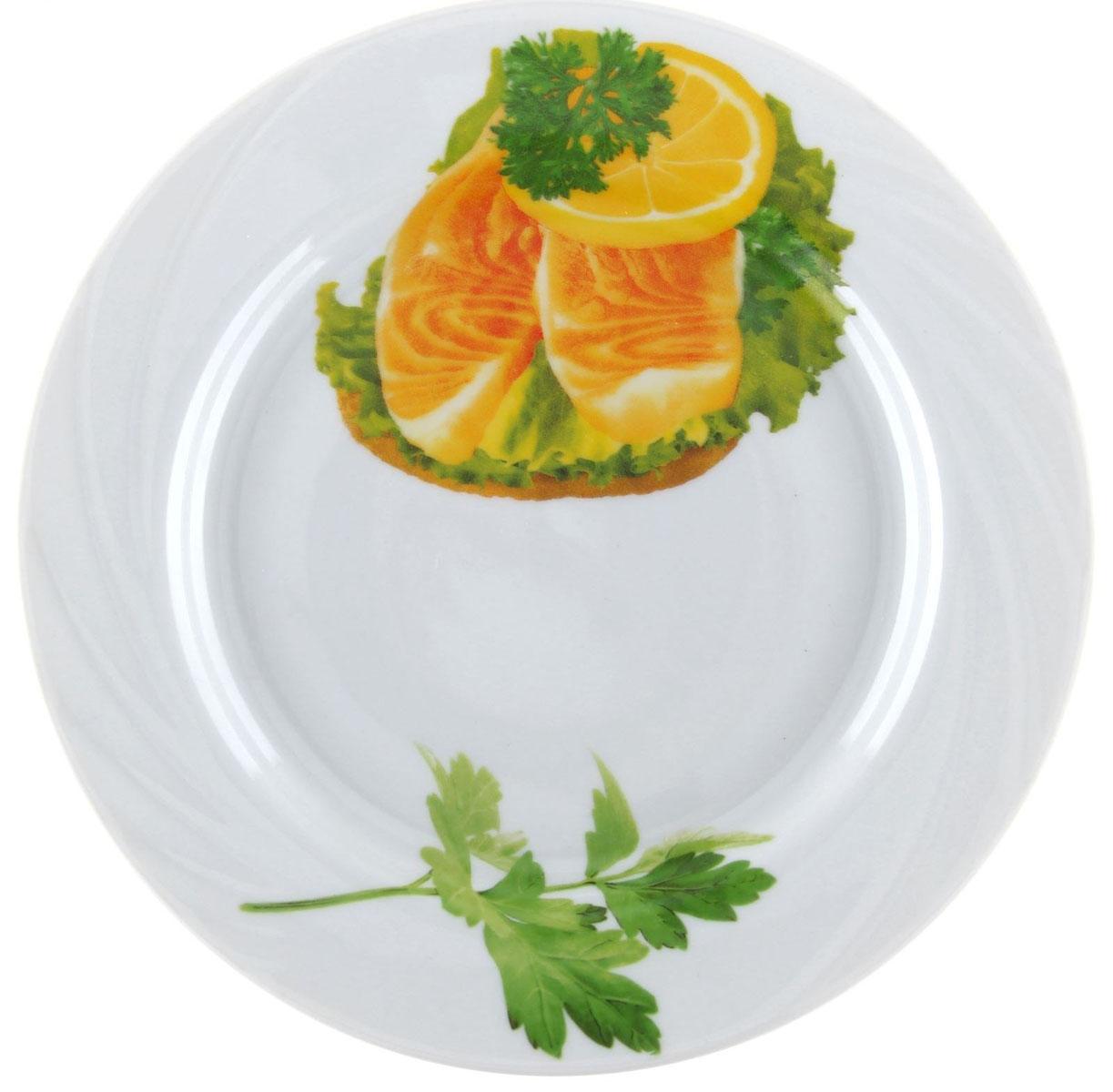 Тарелка мелкая Голубка. Бутерброды, диаметр 20 см1303756Мелкая тарелка Голубка. Бутерброды выполнена из высококачественного фарфора и оформлена изображением бутербродов с рыбой. Изделие сочетает в себе изысканный дизайн с максимальной функциональностью. Она прекрасно впишется в интерьер вашей кухни и станет достойным дополнением к кухонному инвентарю. Тарелка Голубка. Бутерброды подчеркнет прекрасный вкус хозяйки и станет отличным подарком. Диаметр: 20 см.