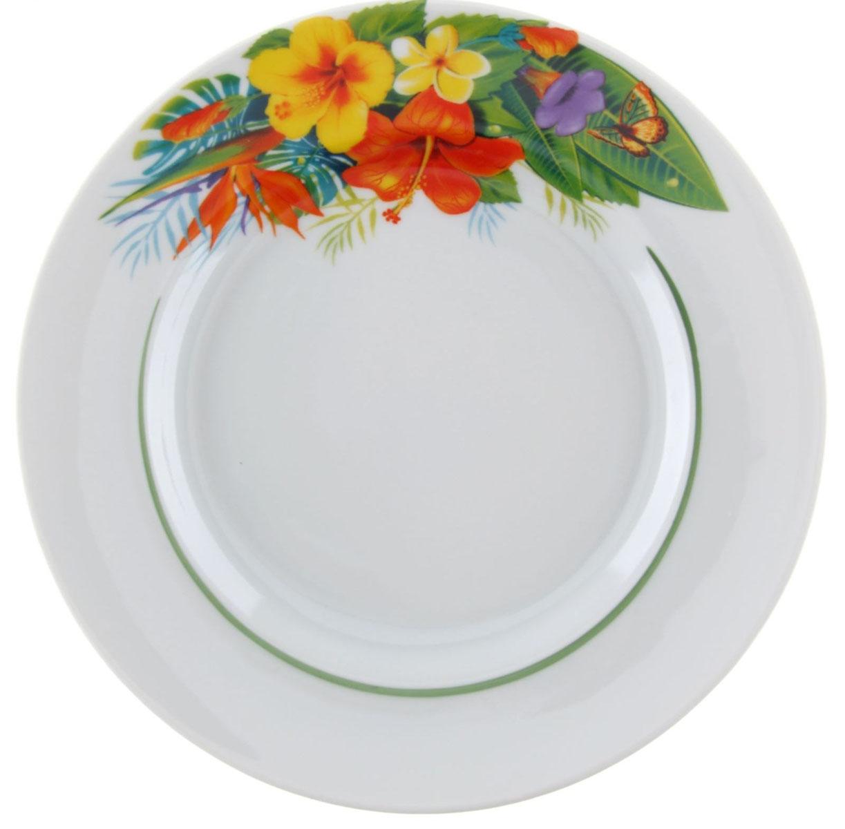 """Мелкая тарелка """"Идиллия. Райский остров"""" выполнена из высококачественного фарфора и украшена изображением цветов. Она прекрасно впишется в интерьер вашей кухни и станет достойным дополнением к кухонному инвентарю. Тарелка """"Идиллия. Райский остров"""" подчеркнет прекрасный вкус хозяйки и станет отличным подарком. Диаметр: 20 см."""