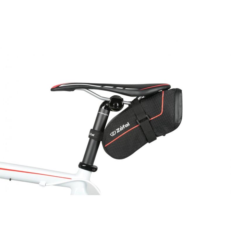 """Подседельная сумка для велосипеда Zefal """"Z Light Pack М"""", изготовленная из   высококачественного текстиля (полиэстер), имеет прорезиненную молнию, которая   защищает от   попадания влаги внутрь. Изделие легко и быстро устанавливается на   подседельный штырь и рамки седла.   Zefal – старейший французский производитель велосипедных аксессуаров   премиального качества, основанный в 1880 году, является номером один на   французском рынке велосипедных аксессуаров.      Гид по велоаксессуарам. Статья OZON Гид"""