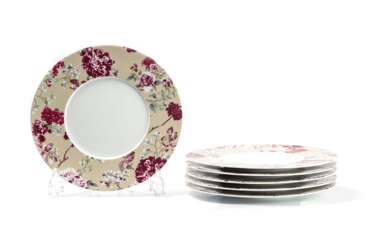 Набор столовых тарелок La Rose des Sables Liberty, диаметр 27 см, 6 шт839002 2150Набор La Rose des Sables Liberty состоит из шести столовых тарелок, выполненных из фарфора высокого качества и украшенных рисунком. Такой набор десертных тарелок станет достойным украшением свежеприготовленного пирожного, выпечки, кусочка вашего фирменного торта или другого десерта. Благодаря безукоризненному дизайну и качеству эти тарелки прослужат вам много лет, напоминая о каждом кусочке любимого лакомства. Диаметр: 27 см.Можно использовать в СВЧ и посудомоечной машине.