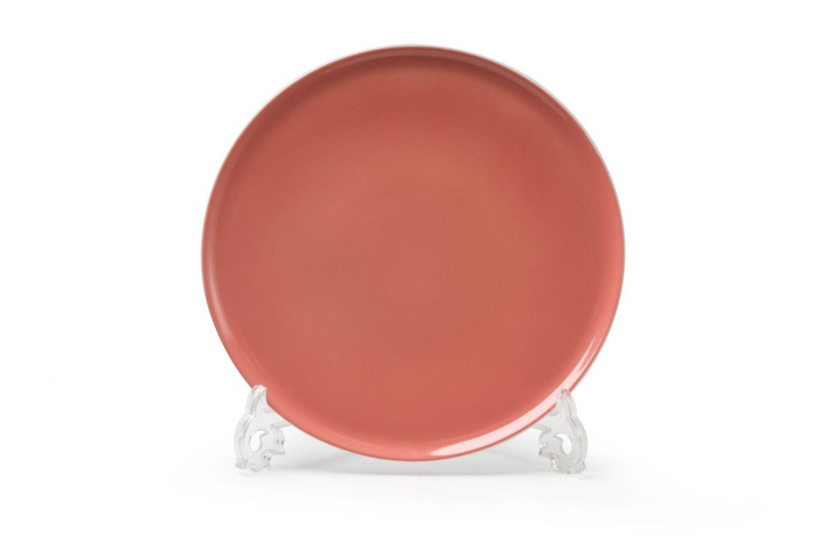 Тарелка обеденная La Rose des Sables Yaka Rose, диаметр 27 см880127 2228Обеденная тарелка La Rose des Sables Yaka Rose выполнена из высококачественного тунисского фарфора, изготовленного из уникальной белой глины. На всех изделиях La Rose des Sables можно увидеть маркировку Pate de Limoges. Это означает, что сырье для изготовления фарфора добывают во французской провинции Лимож, и качество соответствует высоким европейским стандартам. Все производство расположено в Тунисе. Особые свойства этой глины, открытые еще в 18 веке, позволяют создать удивительно тонкую, легкую и при этом прочную посуду. Благодаря двойному термическому обжигу фарфор обладает высокой ударопрочностью, жаропрочностью и великолепным блеском глазури. Коллекция Yaka Rose - яркий пример посуды в современном дизайне. Стильное сочетание лаконичной формы и необычного розового цвета с коралловым оттенком. Прекрасный вариант посуды на каждый день. Можно использовать в СВЧ печи и мыть в посудомоечной машине.