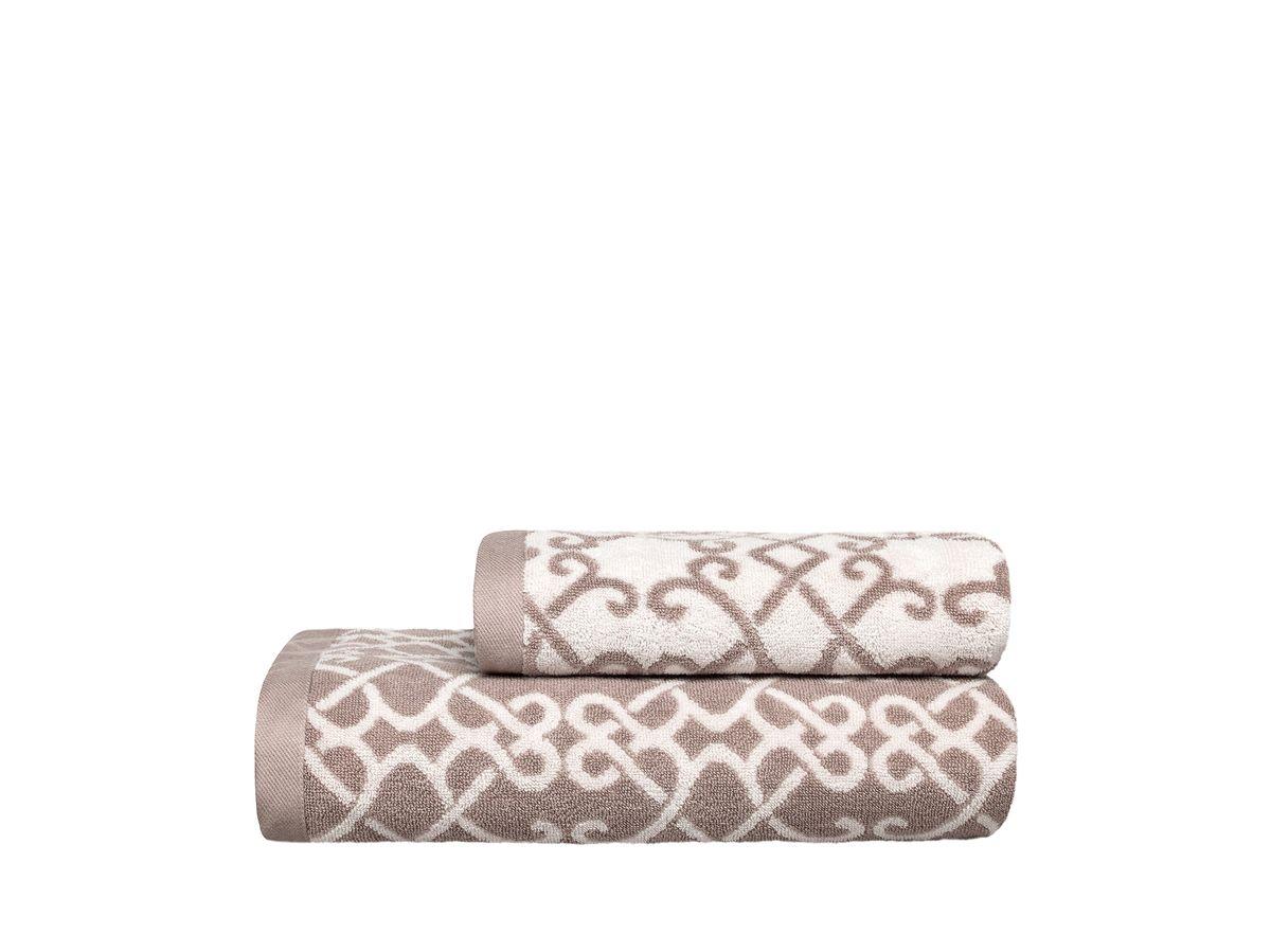 Полотенце Togas Монограмма, цвет: бежевый, 70 х 140 см10.00.01.1009Полотенце Togas Монограмма невероятно гармонично сочетает в себе лучшие качества современного махрового текстиля. Безупречное по качеству, экологичное полотенце из 40% хлопка и 60% модала идеально заботится о вашей коже, особенно после душа, когда вы расслаблены и особо уязвимы.Деликатный дизайн полотенца Togas Монограмма - воплощение изысканной простоты, где на первый план выходит качество материала. Невероятно мягкое волокно модал, превосходящее по своим свойствам даже хлопок, позволяет улучшить впитывающие качества полотенца и делает его удивительно мягким. Модал - это 100% натуральное, экологически чистое целлюлозное волокно. Оно производится без применения каких-либо химических примесей, поэтому абсолютно гипоаллергенно. Полотенце Togas Монограмма, обладающее идеальными качествами, будет поднимать вам настроение.