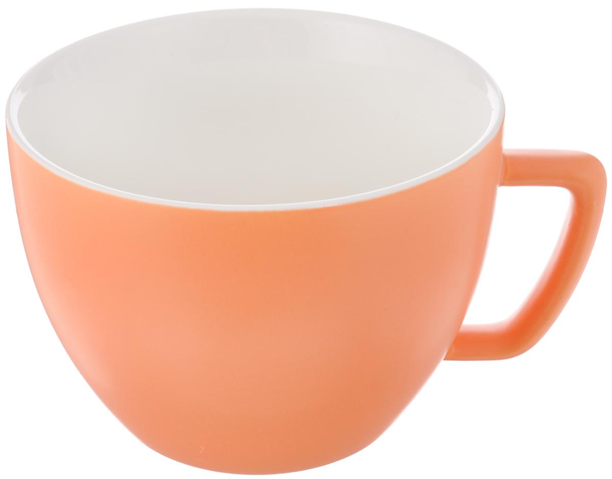 Кружка Tescoma Crema Tone, цвет: оранжевый, 550 мл387148_оранжевыйКружка Tescoma Crema Tone, изготовленная из высококачественного фарфора, прекрасно дополнит интерьер вашей кухни. Изящный дизайн кружки придется по вкусу и ценителям классики, и тем, кто предпочитает утонченность и изысканность. Кружка Tescoma Crema Tone станет хорошим подарком к любому празднику. Диаметр (по верхнему краю): 12 см.Высота: 9 см.