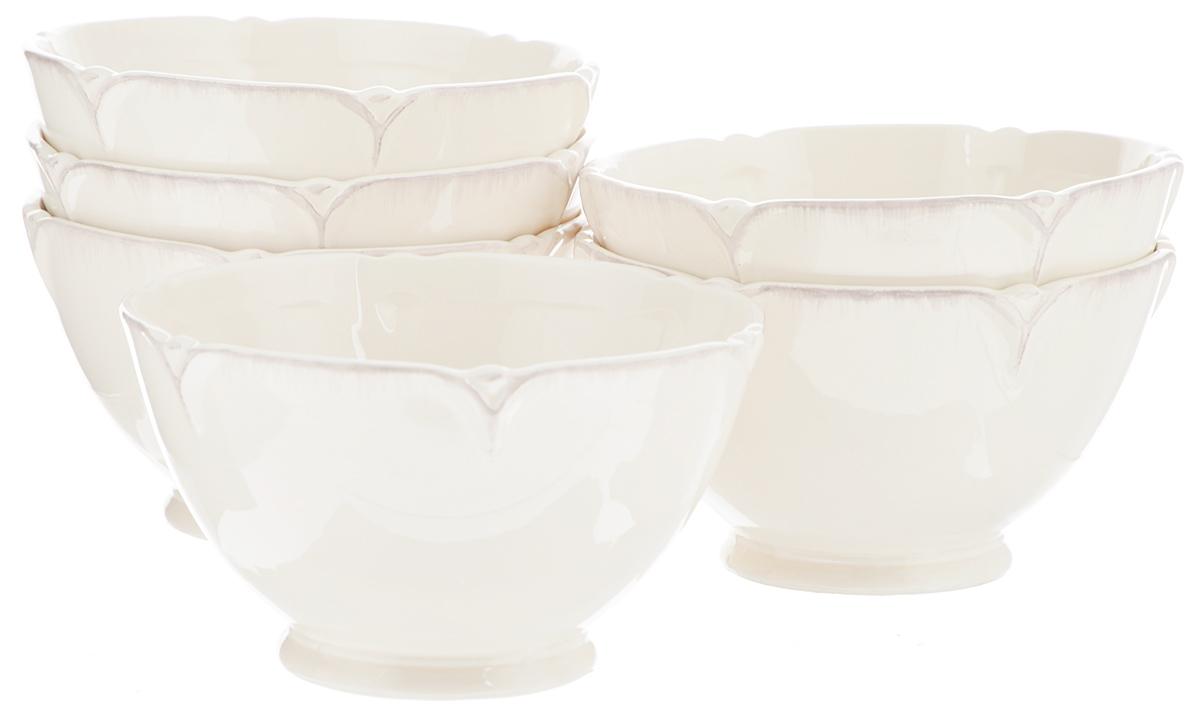Набор салатников Lillo Ideal, диаметр 14 см, 6 шт6K007/0/99109/305Набор Lillo Ideal состоит из 6 салатников одинакового размера Изделия,изготовленные извысококачественной керамики, сочетают в себеизысканный дизайн смаксимальной функциональностью. Они идеальноподходят для сервировки столаи подачи закусок, солений и других блюд.Такие салатники прекрасно впишутся в интерьервашей кухни и станут достойным дополнением ккухонному инвентарю.Диаметр салатника: 14 см. Высота салатника: 8 см.