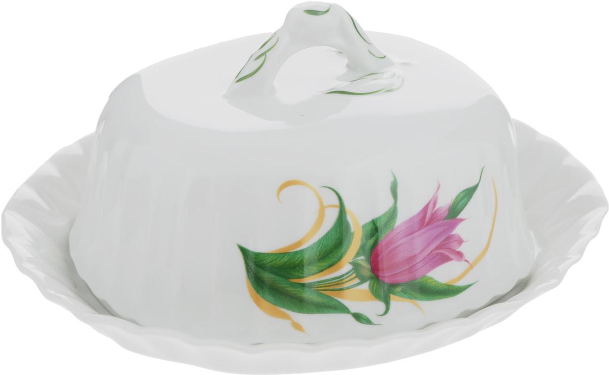 Масленка Тюльпан. Колокольчики507767Масленка Тюльпан. Колокольчики изготовлена из фарфора, покрытого блестящей глазурью. Изделие представляет собой поднос овальной формы, на который, благодаря специальным выемкам, устанавливается крышка. Масленка декорирована красивым изображением цветов. Такая масленка станет изысканным украшением стола и порадует вас и ваших гостей оригинальным дизайном и качеством исполнения. Она прекрасно подойдет в качестве подарка к любому случаю. Размер подноса: 19 х 16 см. Высота подноса: 2,5 см.Размер крышки: 14,5 х 11,8 см.Высота крышки: 8 см.