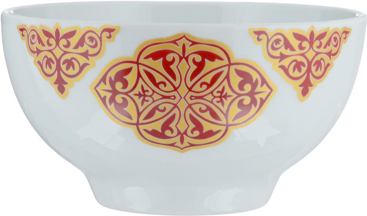 """Пиала """"Восточный"""" изготовлена из высококачественного фарфора. Внешняя стенка оформлена красочным изображением. Изделие прекрасно подойдет для подачи салата или мороженого. Благодаря изысканному дизайну такая пиала станет бесспорным украшением вашего стола. Она дополнит коллекцию кухонной посуды и будет служить долгие годы. Диаметр пиалы по верхнему краю: 9,5 см. Диаметр основания: 4,5 см.Высота пиалы: 5 см."""