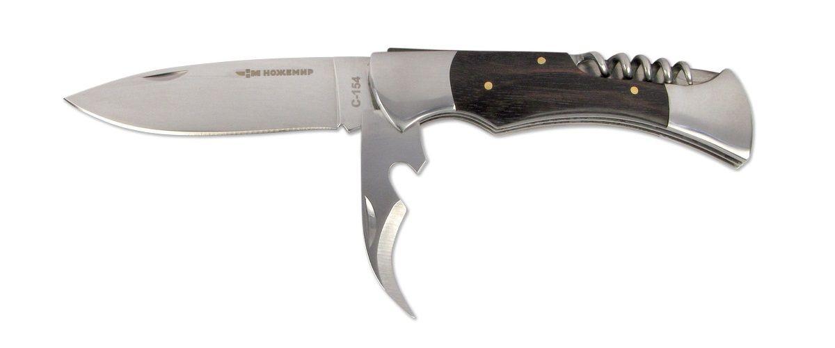 Нож складной Ножемир, длина клинка 10,1 см. C-154C-154 НожемирСкладной нож Ножемир является универсальным для лагеря и кухни, так как помимо самого лезвия, оснащен удобным консервным ножом для банок и штопором. Нож уже поставляется с крепким закрывающимся чехлом из кордуры, что поможет не потерять его при активном отдыхе. Сталь 65х13 прекрасно держит заточку. Рукоять выполнена из стабилизированной древесины. Фиксатор Back lock предотвратит нежелательное сложение ножа.Общая длина ножа: 22,6 см.Твердость клинка: 55-56 HRC.