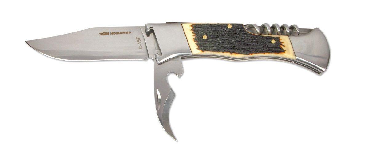 Нож складной Ножемир, со штопором и открывалкой, длина клинка 8,9 смC-157 НожемирНож Ножемир является универсальным для лагеря и кухни, для пикника, так как помимо самого лезвия, имеет удобный консервный нож для банок и штопор. Сталь 65х13 прекрасно держит заточку. Фиксатор Back lock предотвратит нежелательное сложение ножа. Изделие оснащено экстрактором для гильз.Нож уже поставляется с крепким закрывающимся чехлом из кордуры, что поможет не потерять его при активном отдыхе. Общая длина ножа: 22,5 см.Твердость стали: 55-56 HRC.