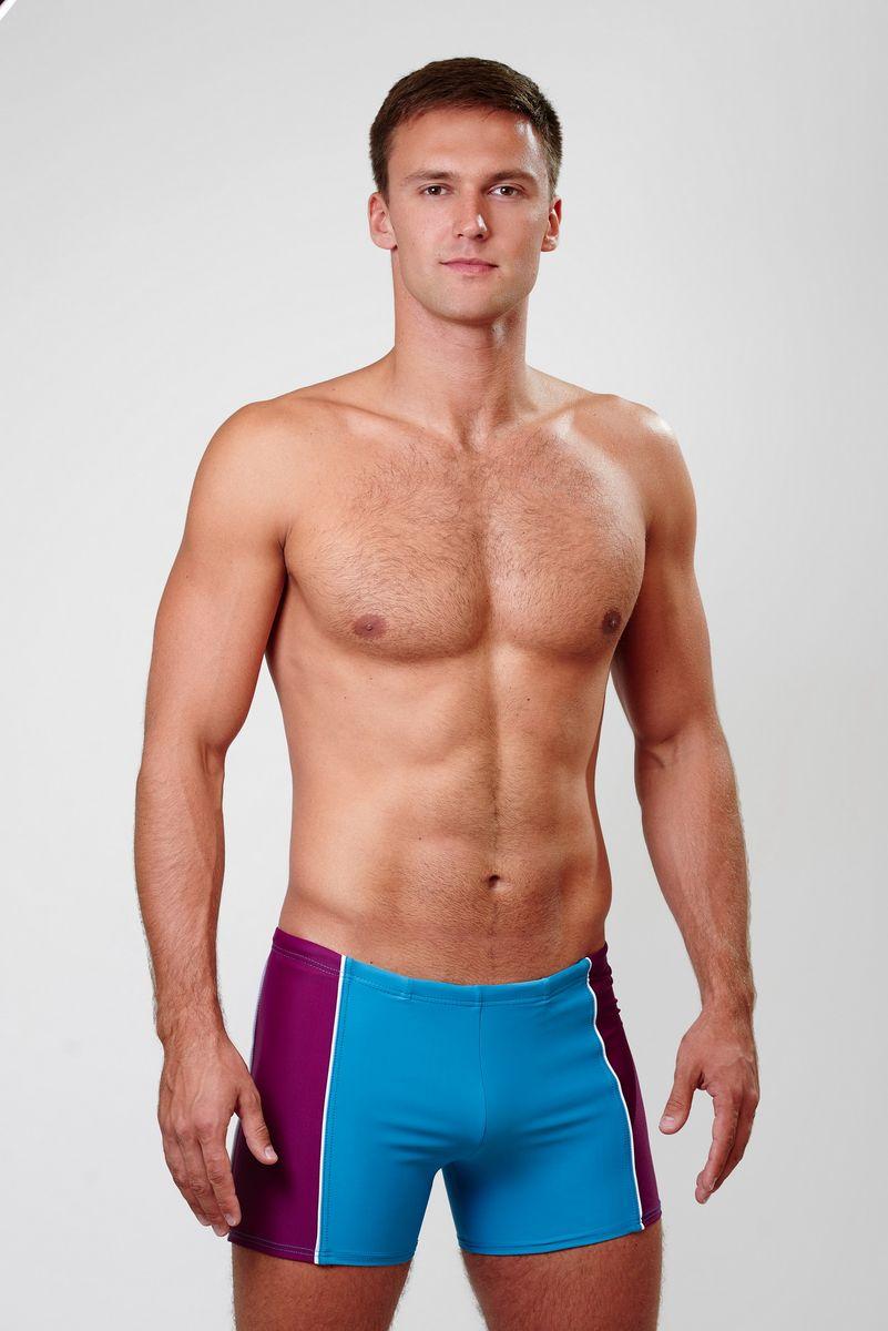 Плавки-шорты мужские Emdi, цвет: бирюзовый, фиолетовый. 07-0812-100. Размер 4207-0812-100_70Мужские плавки-шорты Emdi, изготовленные из эластичного полиамида, быстро сохнут и сохраняют первоначальный вид и форму даже при длительном использовании. Удобная посадка, плоские швы и широкая резинка на талии, регулируемая скрытым шнурком, обеспечат наибольший комфорт. Оформлено изделие контрастными боковыми вставками. Модель создана для тех, кто предпочитает удобство, практичность и современный дизайн. Плавки-шорты подходят как для занятий спортом, так и для пляжного отдыха.