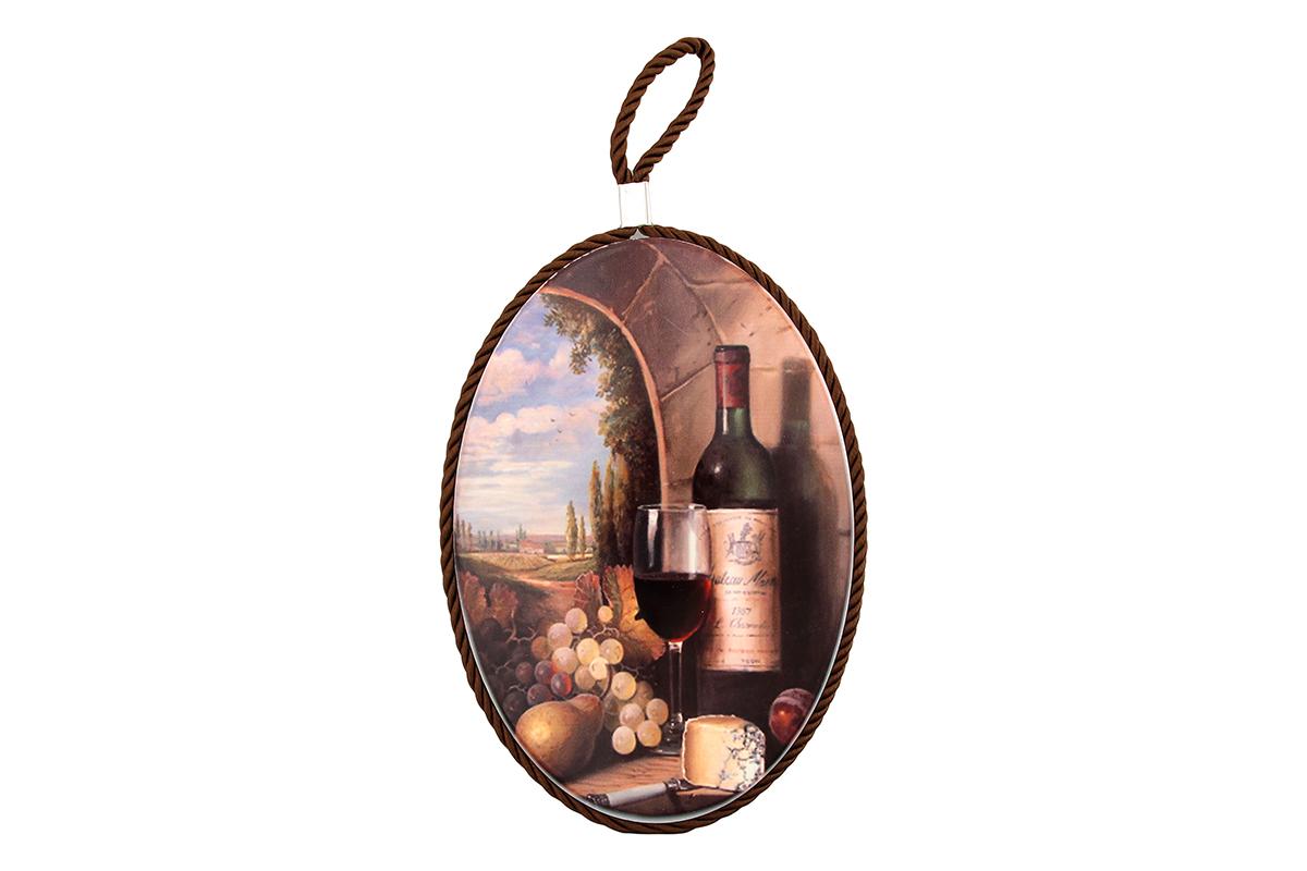 Подставка под горячее Elan Gallery Виноград и вино, 13 х 19 см220118Подставка под горячее Elan Gallery Виноград и вино,выполненная из высококачественной керамики, идеально подойдетдля предохранения вашего стола от воздействия высокихтемператур. Изделие декорировано цветным шнурком с петелькойдля подвешивания. Дно, выполненное из пробки, не дастподставке скользить по поверхности стола.Такая подставка украсит интерьер вашей кухни и подчеркнетпрекрасный вкус хозяина, а также станет отличным подарком. Размер подставки: 13 х 19 х 1 см.