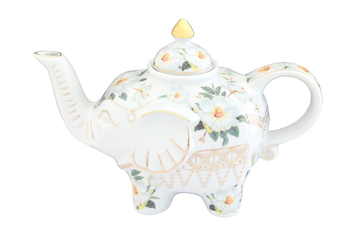 Чайник заварочный Elan Gallery Белый шиповник, 750 мл504058Загадочная страна Индия: чай, слоны, солнце, праздник! Чайник, выполненный в форме слона, будет напоминать Вам об Индии и наполнит Ваш дом солнечным настроением. Изделие имеет подарочную упаковку, идеальный подарок для Ваших близких!Объем чайника: 750 мл.Размер чайника: 23 х 11 х 15 см.