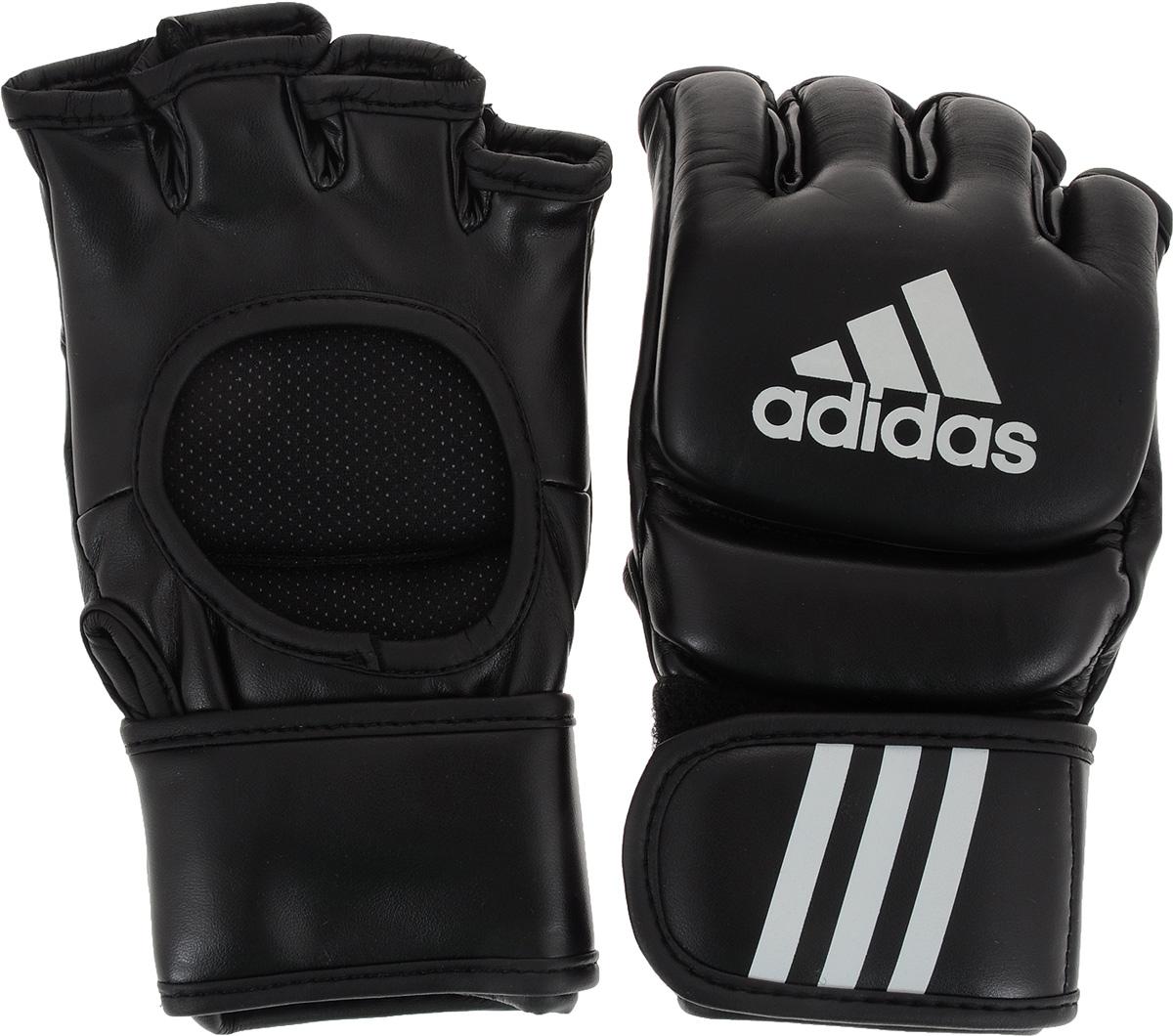 Шингарты для единоборств Adidas UFC Type. Размер SADICSG041Шингарты Adidas UFC Type предназначены для новичков и любителей, для тренировок в домашних условиях, а также могут использоваться для боевого самбо или боев без правил. Выполнены из высококачественной натуральной кожи. Застежка на липучке надежно фиксирует шингарты на руке.