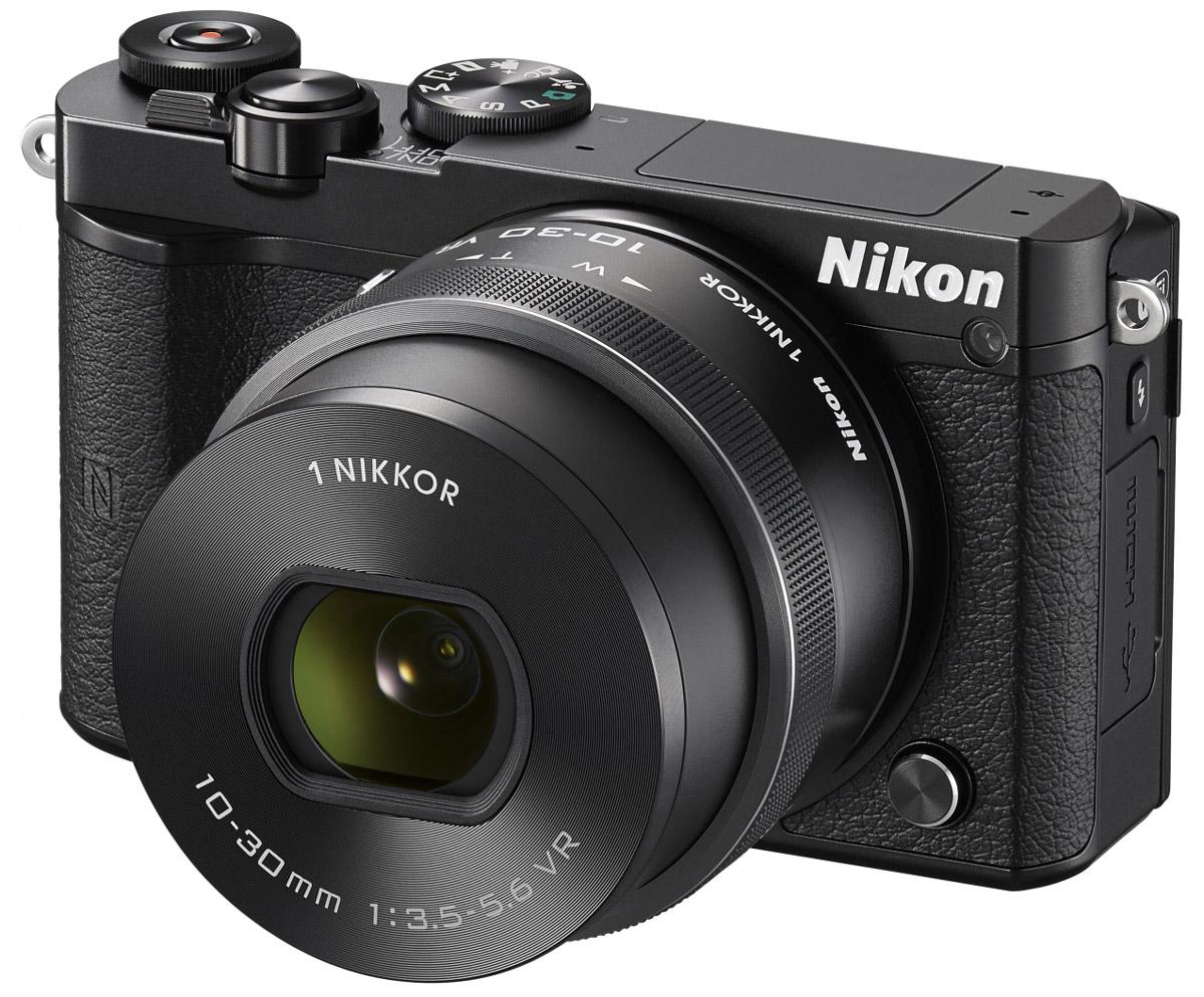 Nikon 1 J5 Kit 10-30 VR, Black цифровая фотокамераVVA241K001Бросьте вызов обыденности с ультрапортативной системной фотокамерой Nikon 1 J5. Создавайте захватывающие 20,8-мегапиксельные изображения и удивительно резкие видеоролики с разрешением 4K. Благодаря исключительной скорости съемки, которая даже выше, чем у цифровых зеркальных фотокамер, вы не упустите интересный кадр.Ваши снимки будут выгодно отличаться от фотографий, снятых при помощи смартфонов, благодаря разрешению 20,8 мегапикселя. Фотокамера Nikon 1 J5 оснащена большой КМОП-матрицей и может использоваться с объективами 1 NIKKOR. Это отличный инструмент для реализации самых смелых творческих замыслов.При скорости 20 кадров в секунду с непрерывной автофокусировкой портативная фотокамера Nikon 1 J5 позволяет снимать сюжеты, недоступные даже для цифровой зеркальной фотокамеры. Благодаря режиму Спорт вы сможете запечатлеть самые стремительные движения и не упустите ни одного важного момента.Записывайте видеоролики сверхвысокой резкости с разрешением 4K? Создавайте неповторимые эффекты, замедляя ход времени с помощью плавного интервального видео или замедленной видеосъемки HD. Создавайте отличные фотографии одновременно с процессом видеосъемки.С легкостью размещайте лучшие снимки в социальных сетях. Фотокамера Nikon 1 J5 оснащена встроенным модулем Wi-Fi и поддерживает технологию NFC, что позволяет делиться высококачественными фотографиями быстрее, чем когда-либо, загрузив их через интеллектуальное устройство.Создавайте отличные фотоснимки и видеоролики. Касаясь сенсорного экрана с малым временем отклика, фотограф может фокусироваться, выполнять съемку и настраивать основные параметры. Поворачивайте экран вниз или вверх, чтобы снимать с необычного ракурса или создавать творческие автопортреты.Устройство так же удобно в управлении, как и цифровые зеркальные фотокамеры. К услугам пользователей диск выбора режимов PSAM, диск управления и кнопка Fn. Раскройте свой творческий потенциал и создавайте яркие изображени