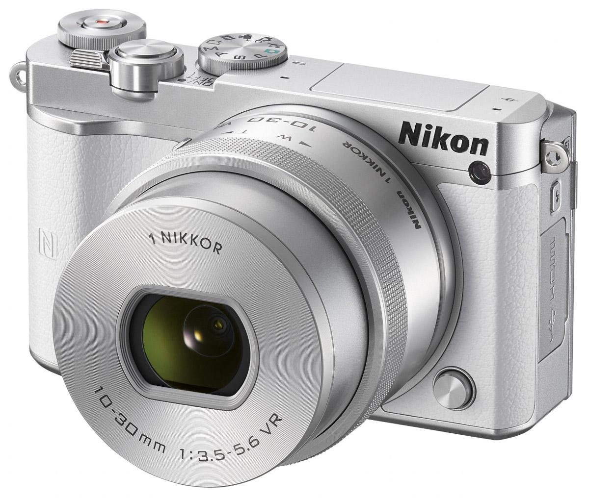 Nikon 1 J5 Kit 10-30 VR, White цифровая фотокамераVVA242K001Бросьте вызов обыденности с ультрапортативной системной фотокамерой Nikon 1 J5. Создавайте захватывающие 20,8-мегапиксельные изображения и удивительно резкие видеоролики с разрешением 4K. Благодаря исключительной скорости съемки, которая даже выше, чем у цифровых зеркальных фотокамер, вы не упустите интересный кадр.Ваши снимки будут выгодно отличаться от фотографий, снятых при помощи смартфонов, благодаря разрешению 20,8 мегапикселя. Фотокамера Nikon 1 J5 оснащена большой КМОП-матрицей и может использоваться с объективами 1 NIKKOR. Это отличный инструмент для реализации самых смелых творческих замыслов.При скорости 20 кадров в секунду с непрерывной автофокусировкой портативная фотокамера Nikon 1 J5 позволяет снимать сюжеты, недоступные даже для цифровой зеркальной фотокамеры. Благодаря режиму Спорт вы сможете запечатлеть самые стремительные движения и не упустите ни одного важного момента.Записывайте видеоролики сверхвысокой резкости с разрешением 4K? Создавайте неповторимые эффекты, замедляя ход времени с помощью плавного интервального видео или замедленной видеосъемки HD. Создавайте отличные фотографии одновременно с процессом видеосъемки.С легкостью размещайте лучшие снимки в социальных сетях. Фотокамера Nikon 1 J5 оснащена встроенным модулем Wi-Fi и поддерживает технологию NFC, что позволяет делиться высококачественными фотографиями быстрее, чем когда-либо, загрузив их через интеллектуальное устройство.Создавайте отличные фотоснимки и видеоролики. Касаясь сенсорного экрана с малым временем отклика, фотограф может фокусироваться, выполнять съемку и настраивать основные параметры. Поворачивайте экран вниз или вверх, чтобы снимать с необычного ракурса или создавать творческие автопортреты.Устройство так же удобно в управлении, как и цифровые зеркальные фотокамеры. К услугам пользователей диск выбора режимов PSAM, диск управления и кнопка Fn. Раскройте свой творческий потенциал и создавайте яркие изображени