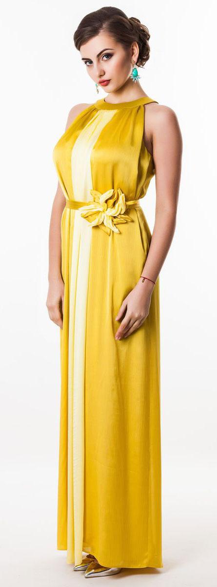 Платье Seam, цвет: золотой. 4620_205. Размер S (44)4620_205Очаровательное вечернее платье Seam, выполненное из высококачественного полиэстера, оно отлично сидит по фигуре и подчеркнет ваши достоинства. Платье-макси без рукавов сзади на шее застегивается на две пуговицы. Модель свободного кроя от начала горловины оформлена элегантными складочками. Платье дополнено контрастным пояском, который закрепляется с помощью заколки-брошки в виде цветка.