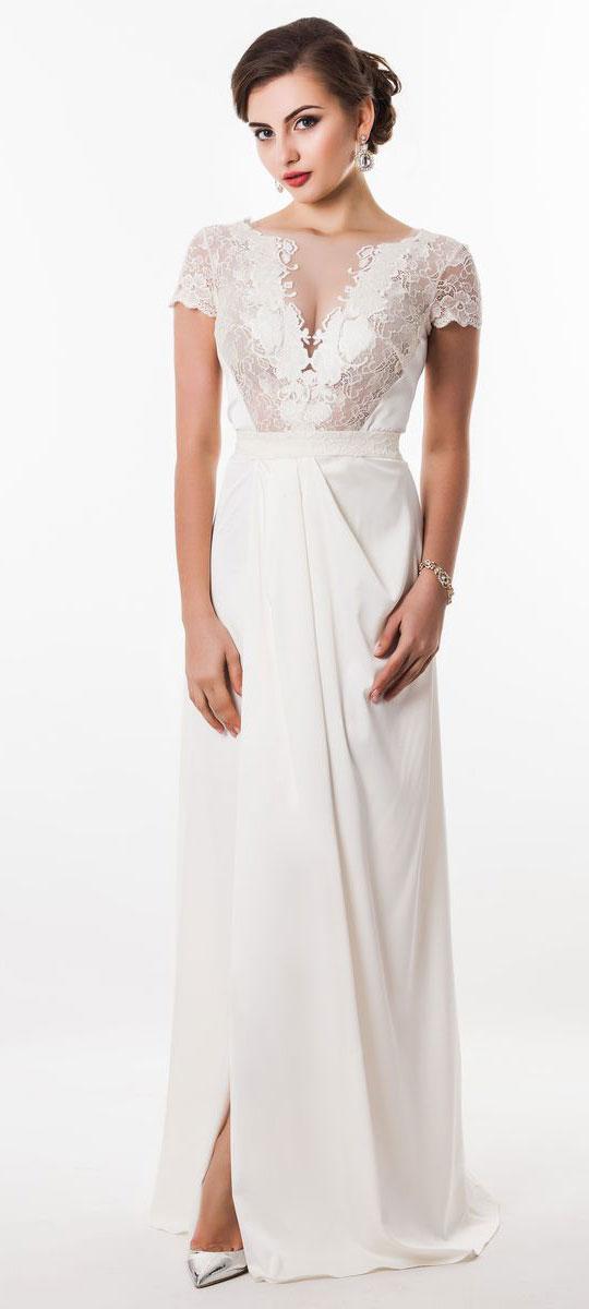 Платье Seam, цвет: жемчужный. 4660_102. Размер M (46)4660_102Стильное платье Seam выполнено из полиэстера с добавлением спандекса. Платье-макси с круглым вырезом горловины и короткими кружевными рукавами. Лиф модели оформлен вставками из сетчатого и кружевного материала и декорирован вышитыми цветами. Двойная юбка модели имеет небольшой запах. По талии платье присобрано на резинку и дополнена мягкими складками. К изделию прилагается текстильный пояс застегивающийся на пуговицу.