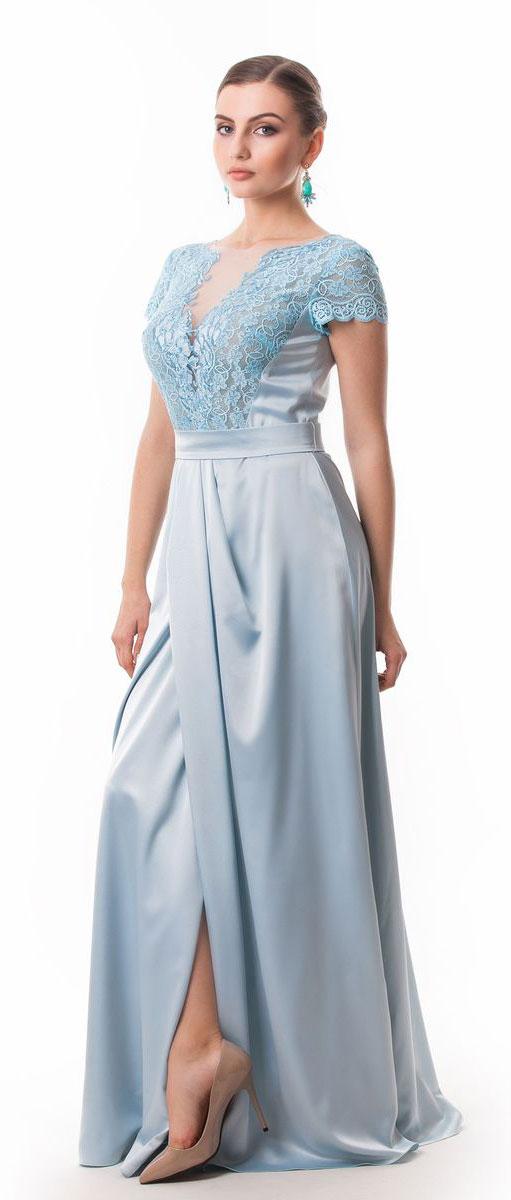 Платье Seam, цвет: светло-голубой. 4660_701. Размер M (46)4660_701Стильное платье Seam выполнено из полиэстера с добавлением спандекса. Платье-макси с круглым вырезом горловины и короткими кружевными рукавами. Лиф модели оформлен вставками из сетчатого и кружевного материала и декорирован вышитыми цветами. Двойная юбка модели имеет небольшой запах. По талии платье присобрано на резинку и дополнена мягкими складками. К изделию прилагается текстильный пояс застегивающийся на пуговицу.
