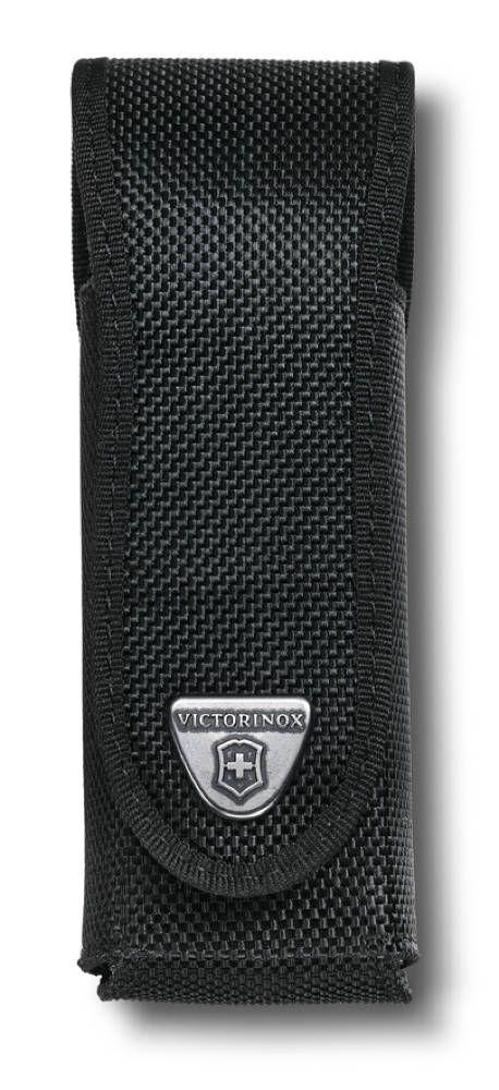 Чехол для ножей Victorinox RangerGrip, цвет: черный. 4.0504.3931009Прочный и практичный черный чехол для ножей Victorinox RangerGrip изготовлен из нейлона и оснащен длинным клапаном. На клапанерасположена металлическая бляха с логотипом компании Victorinox. Есть отсрочка черной лентой по канту. В нижней части чехла по бокамприсутствуют прорези, препятствующие скоплению мусора и отвода влаги. Подходит для ножей размером 130 мм.Каждый чехол Victorinox очень и очень качественный, поскольку каждый специально разрабатывается и производится дляопределенных моделей швейцарских ножей, будь то SwissTool или другой любой другой швейцарский нож. Это означает, что Victorinoxпозаботились, как о прочности конструкции, так и о элегантном дизайне.