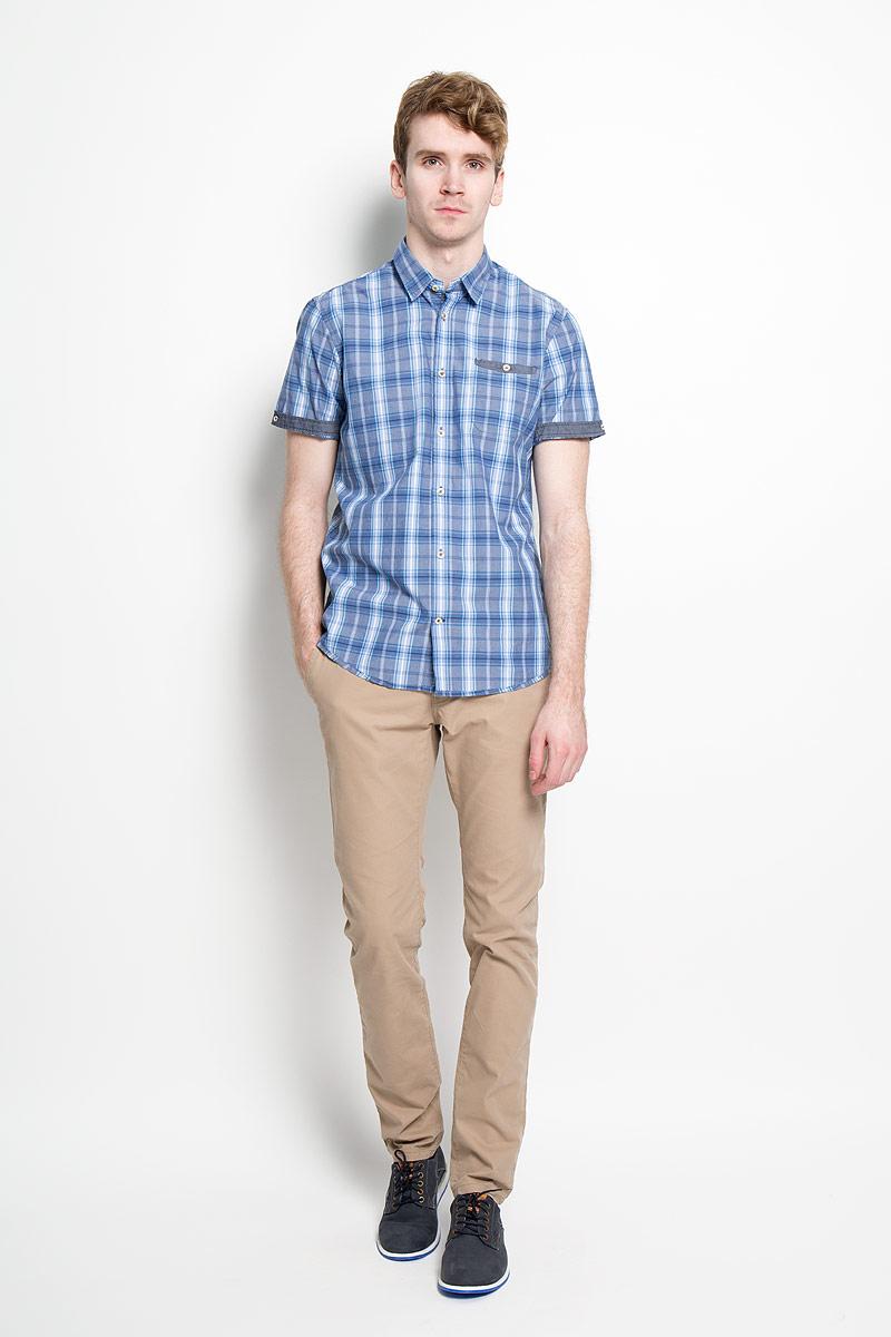 Рубашка мужская Tom Tailor, цвет: синий, голубой, белый. 2031668.00.10_6865. Размер M (48)2031668.00.10_6865Стильная мужская рубашка Tom Tailor, изготовленная из высококачественного хлопка, необычайно мягкая и приятная на ощупь, не сковывает движения и позволяет коже дышать, обеспечивая наибольший комфорт.Модная рубашка с отложным воротником, короткими рукавами и полукруглым низом застегивается на пластиковые пуговицы. Модель оформлена стильным принтом в клетку. Рукава дополнены отворотом и фиксируются с помощью пуговицы, сзади воротник также фиксируется пуговицей. На груди расположен накладной карман. Эта рубашка идеально подойдет для повседневного гардероба.Такая модель порадует настоящих ценителей комфорта и практичности!