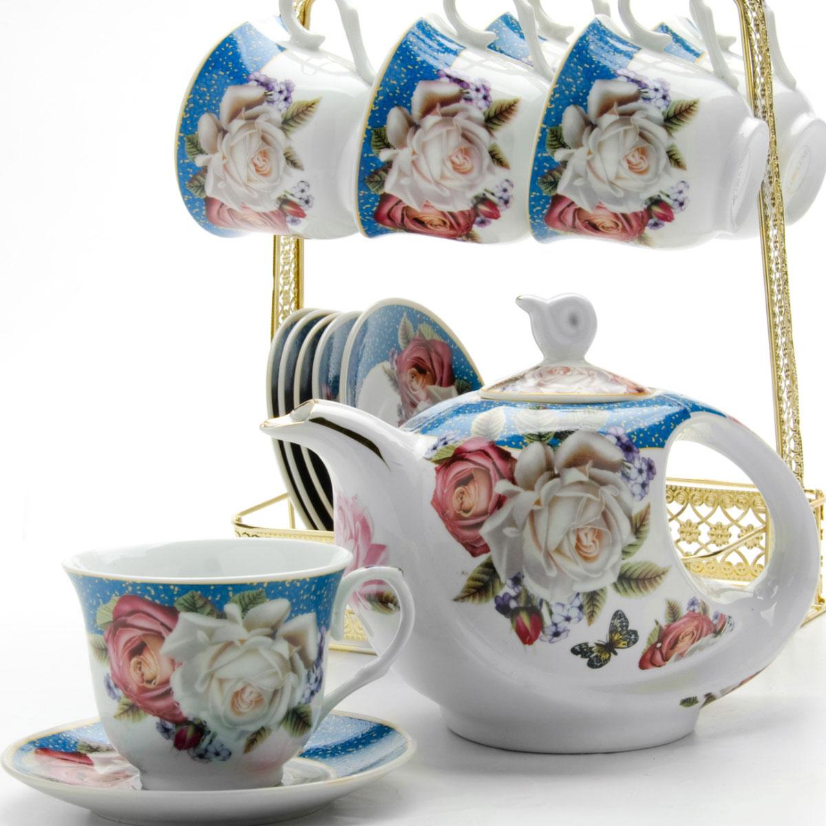 """Чайный набор """"Loraine"""" состоит из шести чашек, шести блюдец и заварочного чайника. Предметы набора изготовлены из керамики и оформлены изображением цветов и бабочек. Все предметы располагаются на удобной металлической подставке с ручкой. Элегантный дизайн набора придется по вкусу и ценителям классики, и тем, кто предпочитает утонченность и изысканность. Он настроит на позитивный лад и подарит хорошее настроение с самого утра. Чайный набор идеально подойдет для сервировки стола и станет отличным подарком к любому празднику.    Объем чашки: 220 мл.  Объем чайника: 950 мл.  Диаметр блюдца: 13,5 см."""