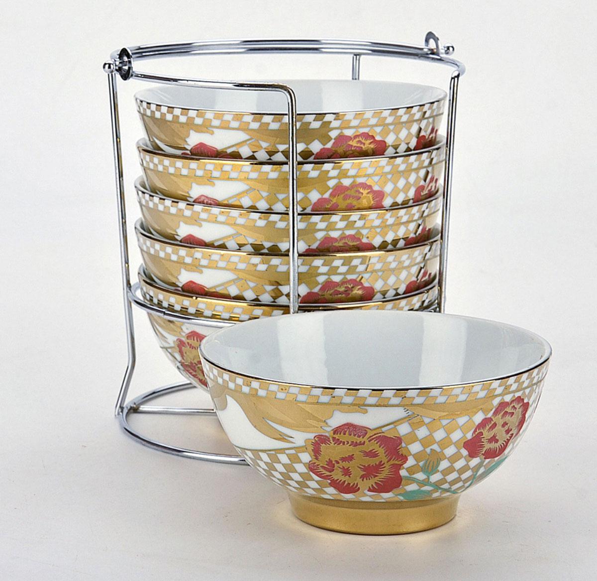 Набор салатников Loraine, с подставкой, 325 мл, 7 предметовG5231Набор состоит из шести салатников, изготовленных из керамики, с нежным цветочным рисунком, который придает посуде особый шарм. Также в наборе идет подставка под салатники из нержавеющей стали. Диаметр салатника: 12,5 см. Высота салатника: 7 см. Объем салатника: 325 мл.