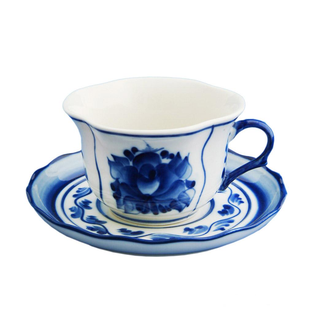 Чайная пара Лютик. 993033412993033412Чайная пара Лютик состоит из чашки и блюдца. Оригинальный яркий дизайн, несомненно, придется вам по вкусу.Чайная пара Лютик украсит ваш кухонный стол, а также станет замечательным подарком к любому празднику.