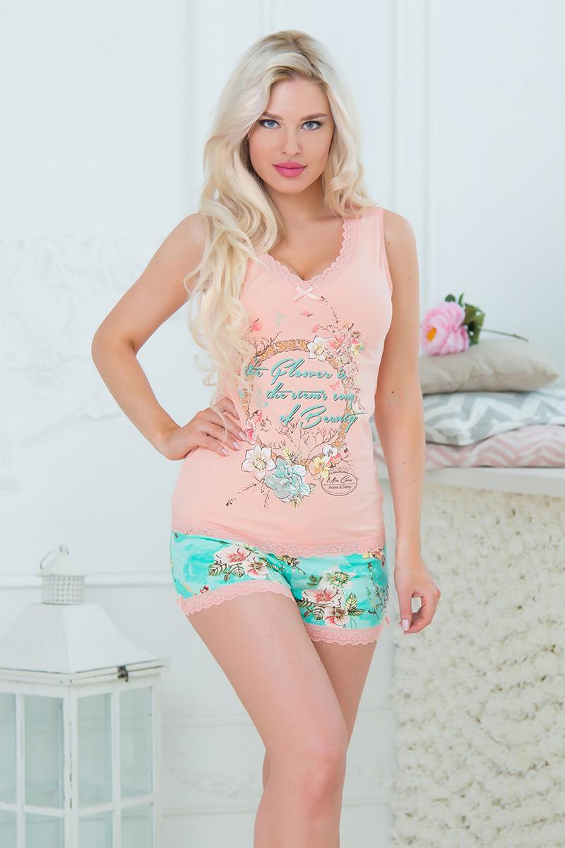 Пижама женская Mia Cara: майка, шорты, цвет: оранжевый, бирюзовый. SS16-MCUZ-662_манго. Размер 46/48SS16-MCUZ-662_мангоЖенская пижама Mia Cara, состоящая из майки и шорт, идеально подойдет для отдыха и сна. Модель выполнена из высококачественного хлопка с добавлением эластана, очень мягкая на ощупь, не сковывает движения, хорошо пропускает воздух. Майка с V-образным вырезом горловины оформлена цветочным принтом и надписями, дополнена кружевной оборкой и текстильным бантиком. Шорты с широкой эластичной резинкой в поясе понизу дополнены кружевной оборкой и бантиками.