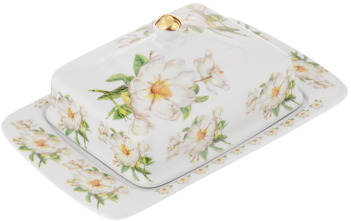 Масленка Loraine Бутон. 2109321093Великолепная масленка Loraine Бутон, выполненная из высококачественной керамики с красивым цветочным рисунком, предназначена для красивой сервировки и хранения масла. Она состоит из подноса и крышки. Масло в ней долго остается свежим, а при хранении в холодильнике не впитывает посторонние запахи. Масленка Loraine Бутон идеально подойдет для сервировки стола и станет отличным подарком к любому празднику.Размер подноса: 20,5 х 13,5 х 2 см.Размер крышки: 14 х 11,5 х 6 см.