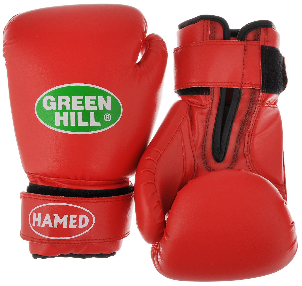 Перчатки боксерские детские Green Hill Hamed, цвет: красный. Вес 6 унцийBGHC-2022_манжета краснаяДетские боксерские перчатки Green Hill Hamed прекрасно подойдут для будущих чемпионов. Верх выполнен из искусственной кожи, наполнитель - из пенополиуретана. Перфорированная поверхность в области ладони позволяет создать максимально комфортный терморежим во время занятий. Широкий ремень, охватывая запястье, полностью оборачивается вокруг манжеты, благодаря чему создается дополнительная защита лучезапястного сустава от травмирования. Перчатки прекрасно сидят на руке. Застежка на липучке способствует быстрому и удобному одеванию перчаток, плотно фиксирует перчатки на руке.