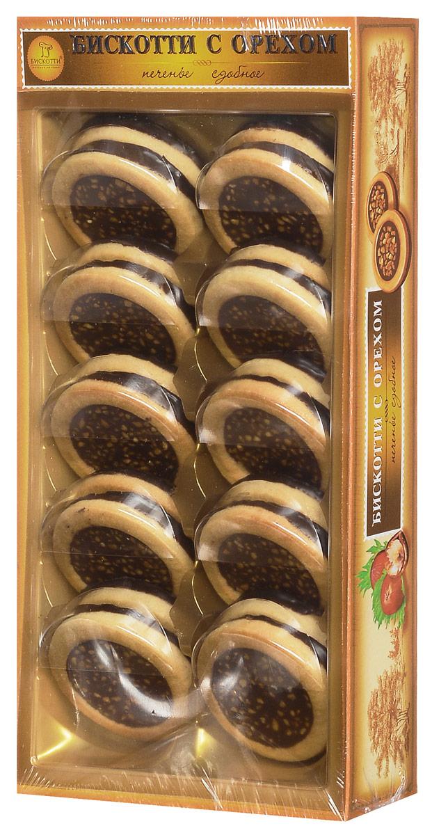 Бискотти печенье сдобное с орехом, 245 гищд049Тертый фундук входит и в состав теста, и в состав тающей во рту шоколадно-ореховой начинки. Сверху печенье посыпано дробленым орехом, обжаренным в карамели, а его донышко покрыто шоколадной глазурью.