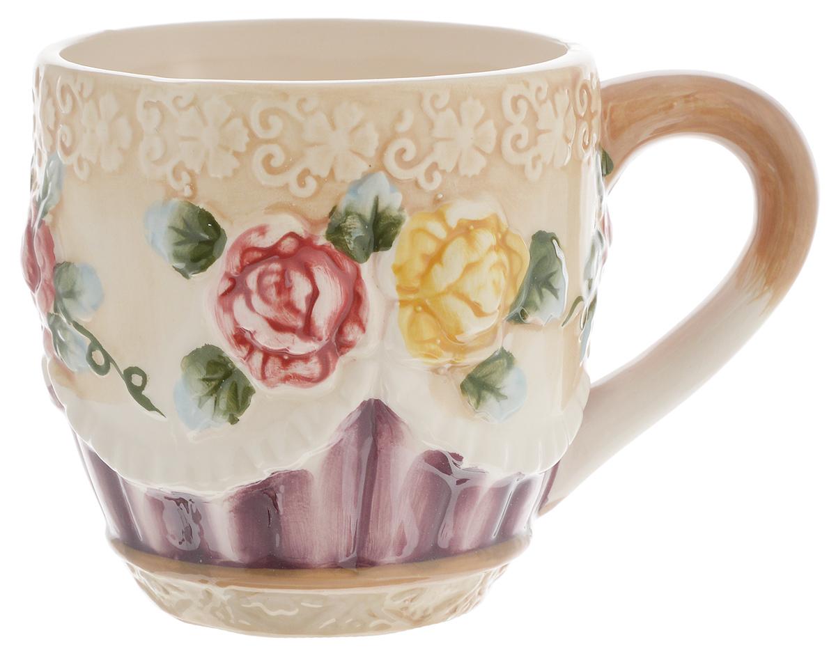 Кружка Loraine, цвет: светло-коричневый, зеленый, фиолетовый, 310 мл. 2244122441Кружка Loraine выполнена из прочной керамики высокого качества с объемным дизайном в виде цветов. Она станет отличным дополнением к сервировке семейного стола и замечательным подарком для ваших родных и друзей.Диаметр кружки (по верхнему краю): 8,8 см.