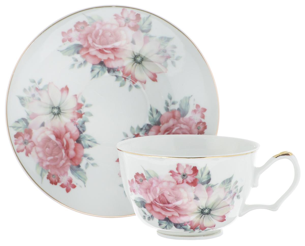 Чайная пара Loraine, 2 предмета. 2459324593Чайная пара Loraine состоит из чашки и блюдца, выполненныхиз высококачественной керамики. Изделия, украшенные яркимизображением цветов, имеют изысканный внешний вид.Чайная пара Loraine впишется в любой интерьер кухни истанет отличным подарком для ваших родных и близких. Объем чашки: 250 мл.Диаметр чашки (по верхнему краю): 9,8 см.Высота чашки: 6,2 см. Диаметр блюдца: 15,2 см.Высота блюдца: 2 см.