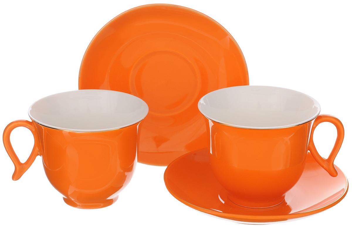Набор чайный Loraine, цвет: белый, оранжевый, 4 предмета. 2474924749Набор Loraine выполнен из высококачественного фарфора. Изящный дизайн и красочность оформления придутся по вкусу и ценителям классики, и тем, кто предпочитает утонченность и изысканность. Чайный набор - идеальный и необходимый подарок для вашего дома и для ваших друзей в праздники, юбилеи и торжества! Он также станет отличным корпоративным подарком и украшением любой кухни. Чайный набор упакован в подарочную коробку из плотного цветного картона. Внутренняя часть коробки задрапирована белым атласом. Объем чашки: 220 мл. Диаметр чашки (по верхнему краю): 9,5 см. Высота чашки: 7,5 см.Диаметр блюдца: 14 см. Высота блюдца: 2,5 см.