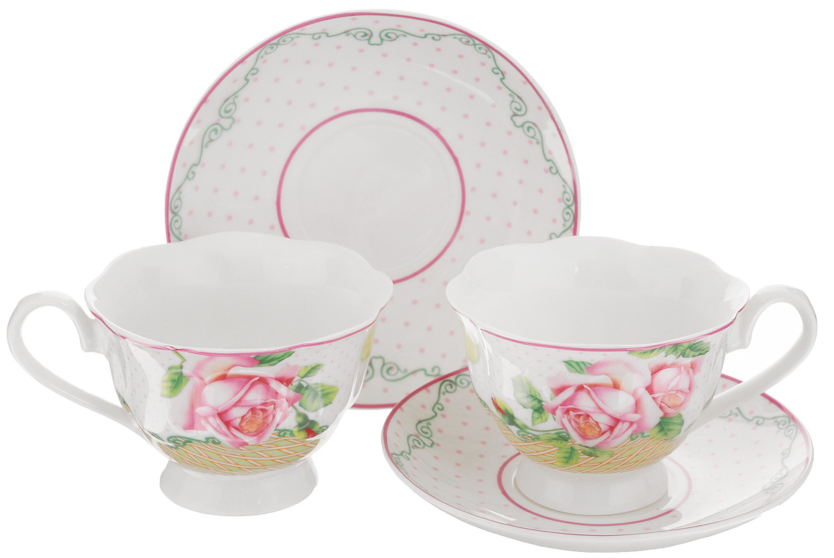 Набор чайный Loraine Розы, 4 предмета. 2300523005Чайный набор Loraine Розы состоит из двух чашек и двух блюдец, выполненных из высококачественного костяного фарфора. Чашки оформлены красивым цветочным рисунком. Такой набор красиво дополнит сервировку стола к чаепитию. Благодаря изысканному дизайну и качеству исполнения, такой набор станет замечательным подарком для ваших друзей и близких. Набор упакован в подарочную коробку в форме сердца, задрапированную белой атласной тканью. Объем чашки: 200 мл. Диаметр чашки (по верхнему краю): 9,5 см. Высота чашки: 6,5 см. Диаметр блюдца: 14 см.