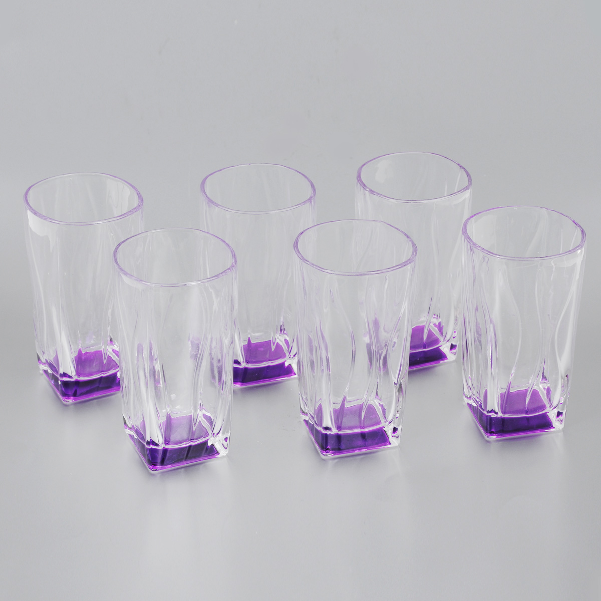 Набор стаканов Loraine, цвет: прозрачный, сиреневый, 290 мл, 6 шт24071Набор Loraine состоит из 6 стаканов, выполненных из высококачественного стекла. Изделия декорированы изысканным рельефом, дно изделий цветное. Благодаря такому набору пить напитки будет еще вкуснее. Набор стаканов Loraine станет также отличным подарком на любой праздник. Подходит для горячих и холодных напитков. Не рекомендуется мыть в посудомоечной машине. Диаметр стакана (по верхнему краю): 6,5 см. Высота стакана: 12,5 см.