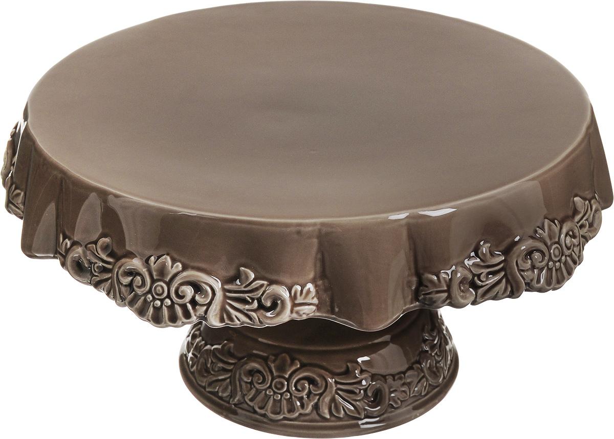 Блюдо для торта Patricia Брауни, на ножке, диаметр 28 смIM18-0103Блюдо для торта Patricia Брауни выполнено из фаянса в виде столика с ажурной скатертью. Посуда обладаетгладкой непористой поверхностью и не впитываетзапахи, ее легко и просто мыть. Изящный дизайн придется по вкусу иценителям классики, и тем, кто предпочитаетутонченность и изысканность.Нерекомендуется мыть в посудомоечной машине ииспользовать в микроволновой печи.Диаметр блюда: 28 см.Высота блюда: 15,5 см.
