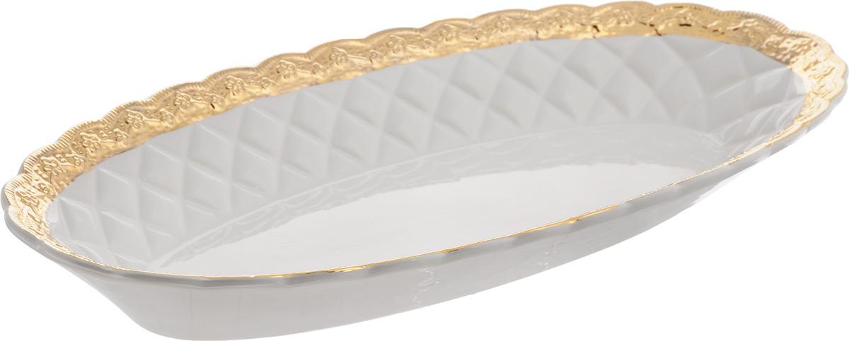 Блюдо Patricia Вивиана, 45,5 х 22,5 х 5,5 смIM18-0204Оригинальное блюдо Patricia Вивиана - прекрасное дополнение праздничного стола. Изделие, выполненное из высококачественного фаянса, оформлено рельефной поверхностью. Блюдо сочетает в себе изысканный дизайн с максимальной функциональностью. Оно идеально подойдет для сервировки стола и станет отличным подарком к любому празднику.Не рекомендуется использовать в микроволновой печи и мыть в посудомоечной машине. Размер блюда (по верхнему краю): 45,5 х 22,5 см. Высота блюда: 5,5 см.