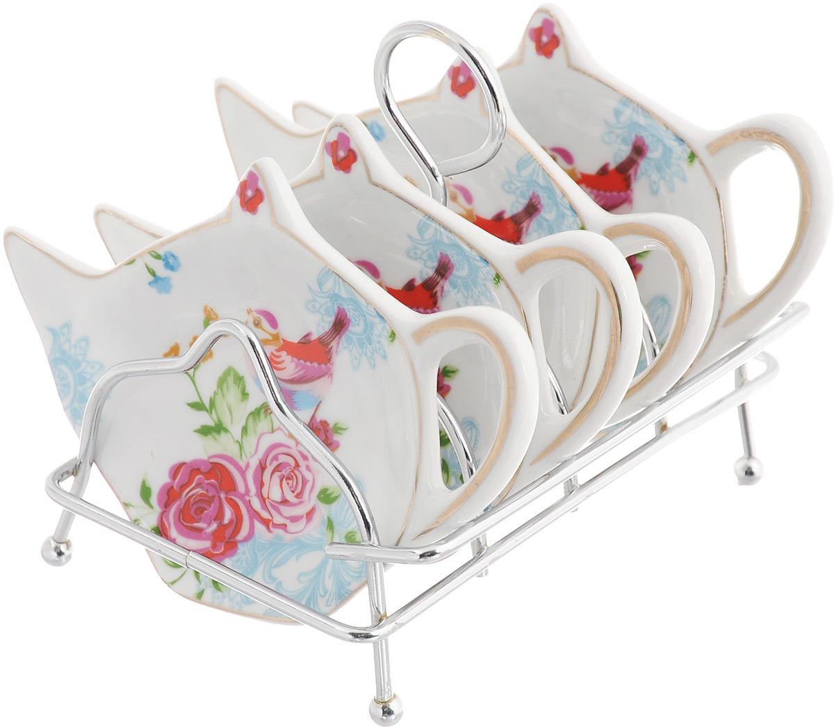 Набор подставок для чайных пакетиков Patricia Райская птичка, 5 предметовIM56-0312Набор подставок Patricia Райская птичка, изготовленный из высококачественного фарфора, порадует вас оригинальностью и дизайном. Подставки выполнены в форме чайничка и оформлены ярким рисунком. В комплект входит металлическая подставка.Можно мыть в посудомоечной машине и использовать в микроволновой печи. Размер подставки для чайных пакетиков: 11,5 х 8 см. Размер металлической подставки: 12 х 9 х 10 см.