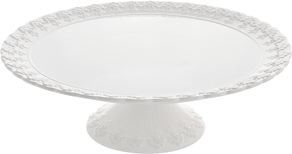 Блюдо для торта Patricia Версаль, диаметр 33 смIM18-0004Блюдо для торта Patricia Версаль выполнено из фаянса с рельефной поверхностью. Посуда обладает гладкой непористой поверхностью и не впитывает запахи, ее легко и просто мыть. Изящный дизайн и красочность оформления придутся по вкусу и ценителям классики, и тем, кто предпочитает утонченность и изысканность.Не рекомендуется мыть в посудомоечной машине и использовать в микроволновой печи.Диаметр блюда: 33 см.