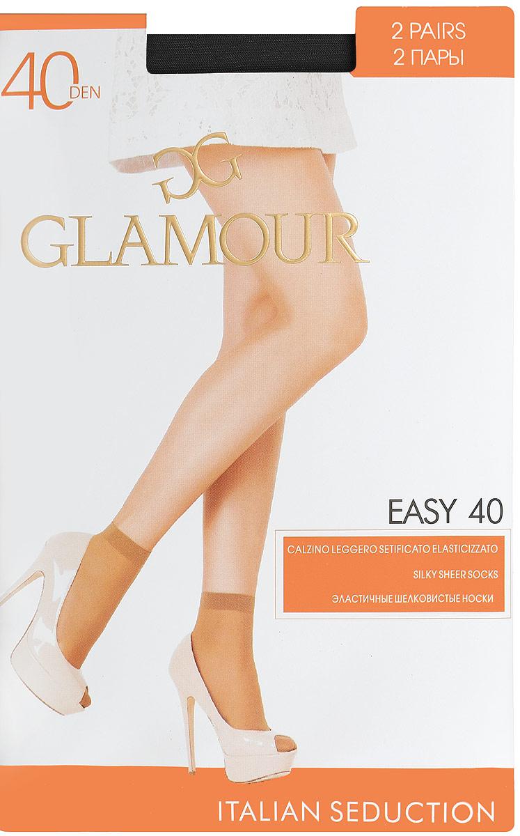 Носки женские Glamour Easy 40, цвет: Nero (черный), 2 пары. 25809. Размер универсальныйEasy 40Удобные женские носки Glamour Easy 40, изготовленные из высококачественного эластичного полиамида, идеально подойдут для повседневной носки. Входящий в состав материала полиамид обеспечивает износостойкость, а эластан позволяет носочкам легко тянуться, что делает их комфортными в носке.Эластичная резинка плотно облегает ногу, не сдавливая ее, обеспечивая комфорт и удобство и не препятствуя кровообращению. Практичные и комфортные носки с укрепленным прозрачным мыском великолепно подойдут к любой открытой обуви. В комплект входят 2 пары носков. Плотность: 40 den.