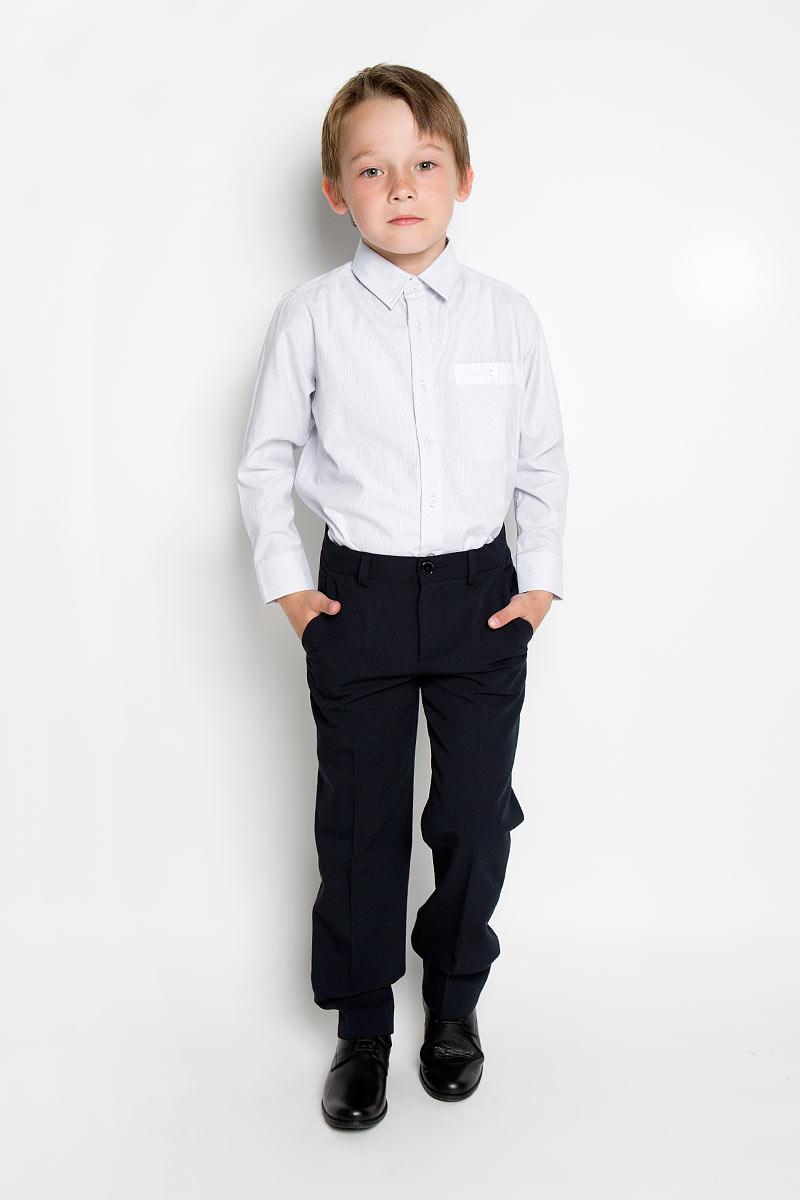 Рубашка для мальчика Scool, цвет: светло-серый. 363032. Размер 158, 13 лет363032Стильная рубашка для мальчика Scool идеально подойдет вашему ребенку. Изготовленная из хлопка с добавлением полиэстера, она мягкая и приятная на ощупь, не сковывает движения и позволяет коже дышать, не раздражает даже самую нежную и чувствительную кожу ребенка, обеспечивая ему наибольший комфорт. Рубашка классического кроя с длинными рукавами и отложным воротничком застегивается на пуговицы. Низ рукавов дополнен манжетами на пуговицах. На груди расположен небольшой накладной карман с застежкой на пуговицу.Современный дизайн и модная расцветка делают эту рубашку стильным предметом детского гардероба. Ее можно носить как с джинсами, так и с классическими брюками.
