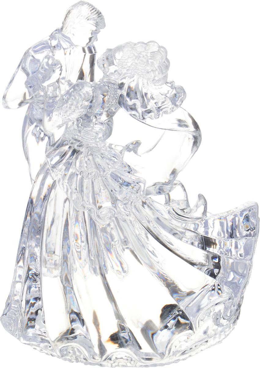 Фигурка для торта Wilton Бианка, высота 14 смWLT-202-424Фигурка для торта Wilton Бианка изготовлена из прозрачного акрила в виде танцующих жениха и невесты. Используется для украшения кондитерских изделий, стола и прочего.