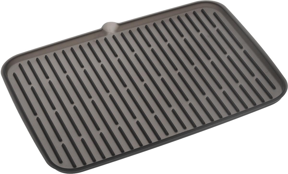 Сушилка для посуды Tescoma Clean Kit, силиконовая, цвет: серый, 42 х 24 см900646_серыйЭластичная сушилка для посуды Tescoma Clean Kit, выполненная из гибкого силикона, защитит кухонную столешницу от влаги. Благодаря ребристой поверхности, которая расположена под наклоном, вода стекает в одну сторону. Направьте боковой носик в раковину и вода будет стекать туда. Если рядом раковины нет, то используйте обратную сторону сушилки, которая будет просто собирать воду внутри.Ваша посуда высохнет быстрее, если после мойки вы поместите ее на легкую, современную сушилку. Сушилка для посуды Tescoma Clean Kit станет незаменимым атрибутом на вашей кухне.