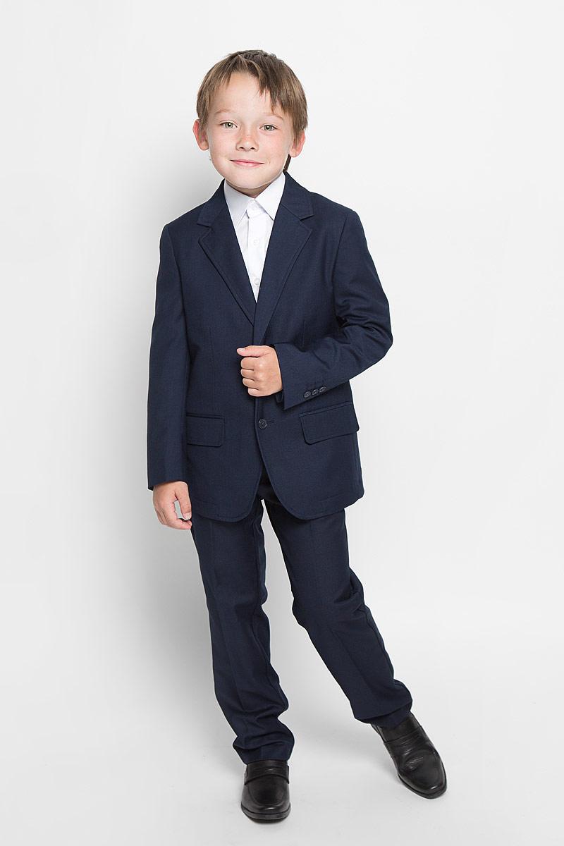 Пиджак для мальчика Scool, цвет: темно-синий. 363019. Размер 146, 11 лет363019Стильный пиджак для мальчика Scool станет отличным дополнением к школьному гардеробу в прохладные дни. Изготовленный из высококачественного материала, он необычайно мягкий и приятный на ощупь, не сковывает движения и позволяет коже дышать, не раздражает нежную кожу ребенка, обеспечивая ему наибольший комфорт.Пиджак с воротничком с лацканами застегивается на пластиковые пуговички. Низ рукавов дополнен декоративными пуговицами. Спереди пиджак оформлен двумя прорезными карманами с клапанами в нижней части и небольшим прорезным кармашком на груди. С внутренней стороны находятся два прорезных кармана, один из которых застегивается на пуговицу. Сзади предусмотрена шлица. В таком пиджачке ваш маленький мужчина будет чувствовать себя комфортно, уютно и всегда будет в центре внимания!