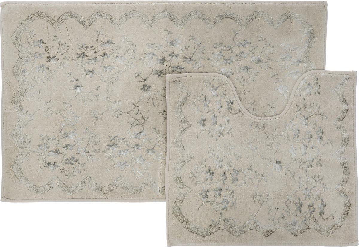 """Необыкновенные коврики для ванной Arya """"Bahar"""" обладают эффектным дизайном, мягким и легким в уходе ворсом, нежным естественным оттенком, а также насыщенным цветом.Набор состоит из двух ковриков, выполненных из хлопка и вискозы. Верхняя часть из ворса 4 мм. Коврики украшены рисунком, который придаст еще большей элегантности дизайну ванной комнаты.Особенности изделий:Края ковриков обработаны.Коврики не требовательны в уходе, если они чрезмерно не пачкаются и не загрязняются. В зависимости от интенсивности использования достаточно раз в месяц или в три месяца привести их в порядок.Коврики легко сворачиваются или складываются и помещаются в емкость для стирки. Данные коврики легко выдержат машинную стирку на бережном цикле при 30°С.Хорошо впитывают влагу, быстро сохнут.Коврик - это необходимый предмет, без которого невозможен комфорт и уют в ванной комнате.Размер ковриков: 60 х 100 см, 50 х 60 см."""