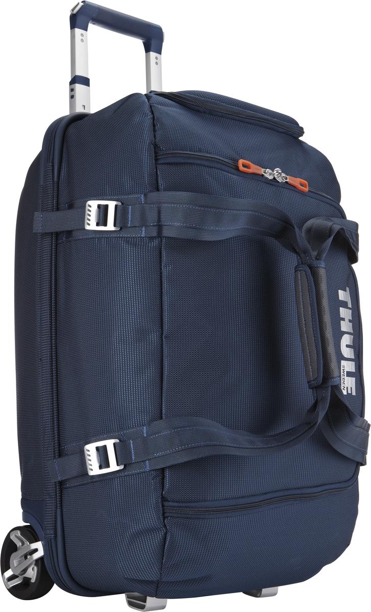 Багажная сумка Thule Crossover Rolling Duffel, на колесах, цвет: темно-синий, 56 л. TCRD13201093Дорожная сумка на колесах Thule Crossover Rolling Duffel - это отличная сумка с широким входом, куда можно с легкостью положить шлем, ботинки, перчатки, куртку и другие туристические принадлежности.Алюминиевый каркас и водостойкий материал делают эту сумку легкой, но и прочной. Надежный экзоскелет и задняя обшивка из полипропилена обеспечат надежную защиту во время путешествий в самых сложных условиях. Крепкие колеса увеличенного размера и телескопические ручки с технологией Thule V-Tubing гарантируют мягкое, плавное и ровное движение в течение многих лет. Регулировочные ремни для подгонки размера сумки в зависимости от количества багажа. Изготовленное по технологии горячей прессовки ударопрочное отделение SafeZone защитит ваши очки, портативную электронику и другие хрупкие вещи (отделение запирается и может быть удалено для освобождения дополнительного места). Главное отделение с отсеками поможет отделить чистое от грязного, мокрое от сухого и деловое от повседневного.