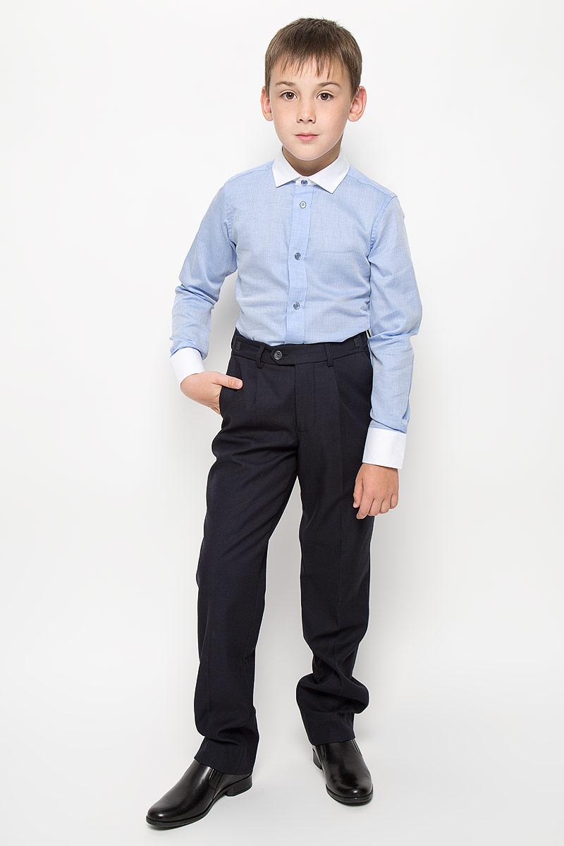 Рубашка для мальчика Orby School, цвет: голубой. 64189_OLB, вар.1. Размер 164, 12-13 лет64189_OLB, вар.1Стильная рубашка для мальчика Orby School идеально подойдет вашему ребенку. Изготовленная из натурального хлопка, она мягкая и приятная на ощупь, не сковывает движения и позволяет коже дышать, обеспечивая наибольший комфорт. Рубашка с длинными рукавами и отложным воротничком по всей длине застегивается на металлические кнопки с имитацией пуговиц, низ застегивается на одну пуговицу. Изделие оформлено принтом в мелкую елочку. Современный дизайн и расцветка делают эту рубашку стильным предметом детского гардероба. Модель можно носить как с джинсами, так и с классическими брюками.